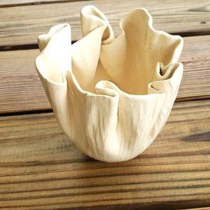 Folded ruffled clay ceramic vase